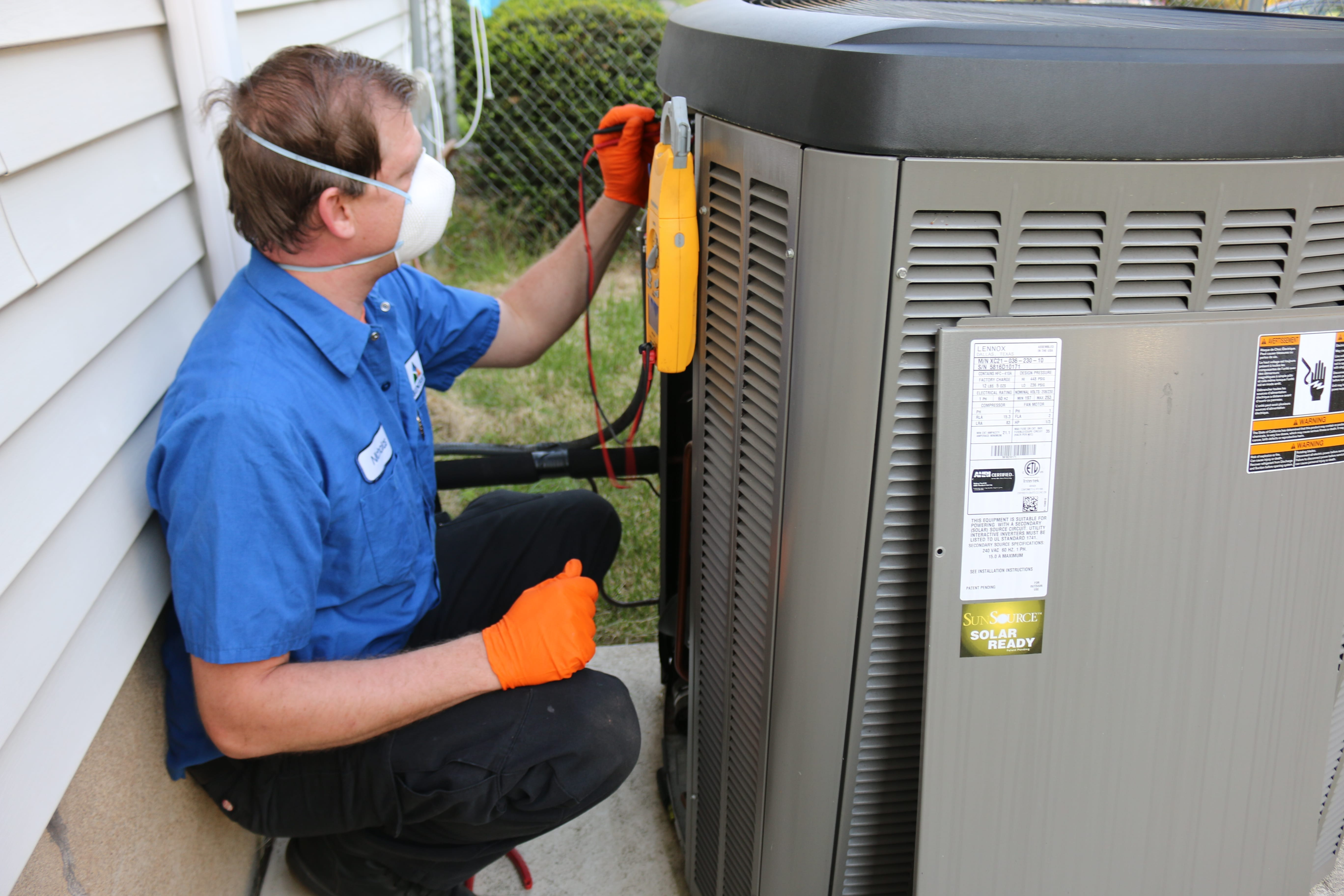 Man fixing air conditioning unit